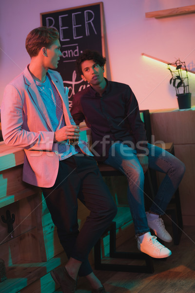 multiethnic men having conversation in bar Stock photo © LightFieldStudios