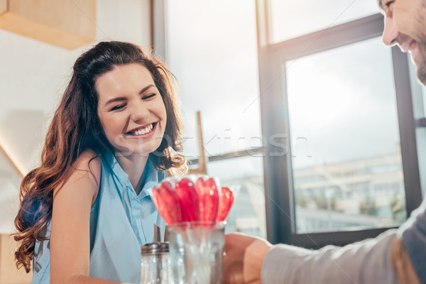 happy couple on date in cafe Stock photo © LightFieldStudios