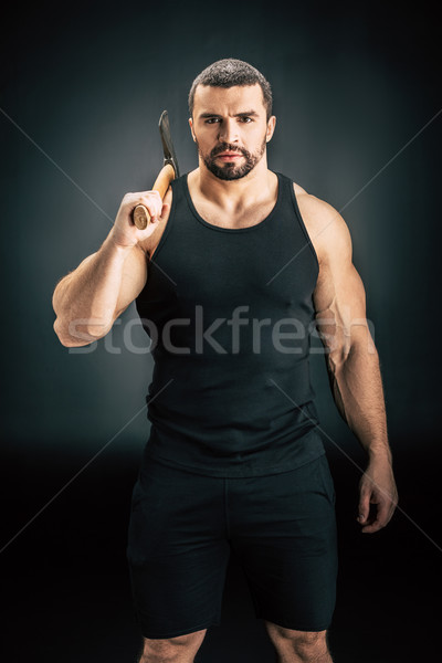sportive man holding axe Stock photo © LightFieldStudios