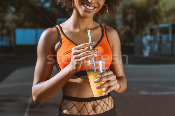 athletic african-american woman drinking juice Stock photo © LightFieldStudios