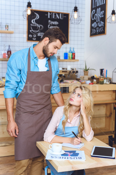 Sérieux café propriétaires jeunes regarder autre Photo stock © LightFieldStudios