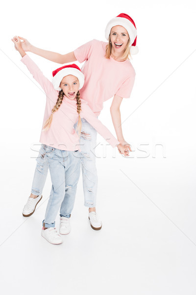 mother and daughter holding hands on christmas Stock photo © LightFieldStudios