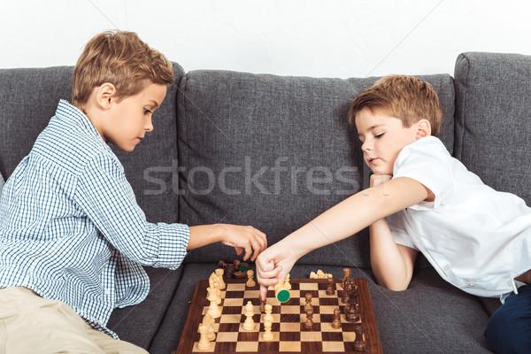 Piccolo ragazzi giocare scacchi cute seduta Foto d'archivio © LightFieldStudios