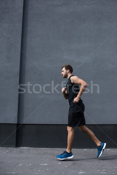спортивный спортсмен бег за пределами вид сбоку выстрел Сток-фото © LightFieldStudios