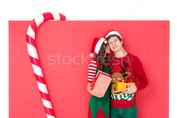couple in santa hats with gifts Stock photo © LightFieldStudios