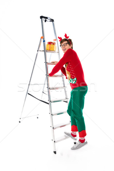 man going up on ladder for gifts Stock photo © LightFieldStudios