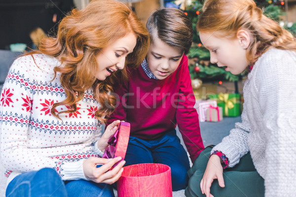 mother and kids opening christmas gift Stock photo © LightFieldStudios