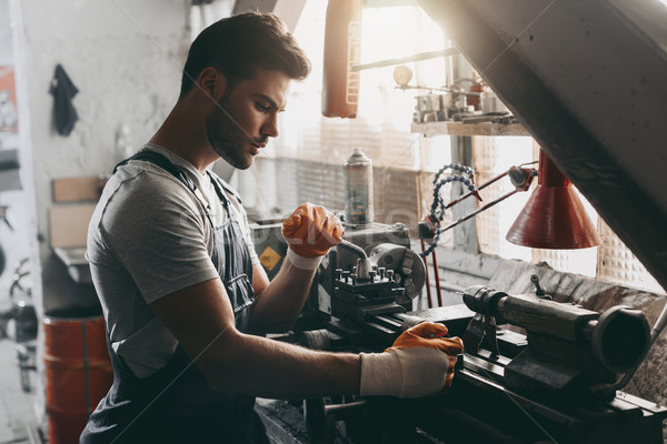 Stock photo: handsome repairman in workshop