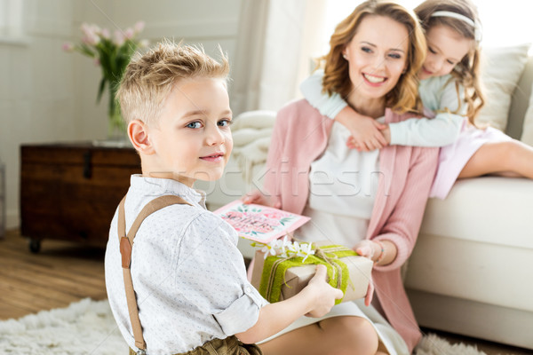 Boy presenting gift to mother Stock photo © LightFieldStudios