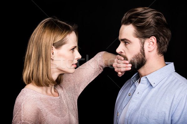 Woman covers mouth of man Stock photo © LightFieldStudios