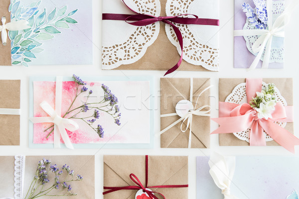 top view of collection of envelopes or invitations isolated on white, wedding invitation card design Stock photo © LightFieldStudios
