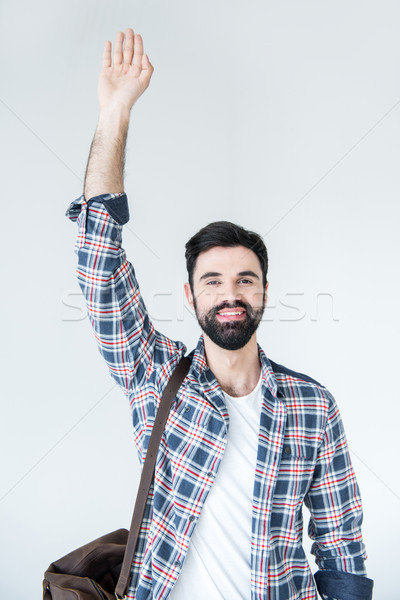 portrait of young bearded man with raising hand in studio on white  Stock photo © LightFieldStudios
