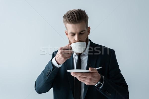 Yakışıklı sakallı işadamı içme kahve gri Stok fotoğraf © LightFieldStudios