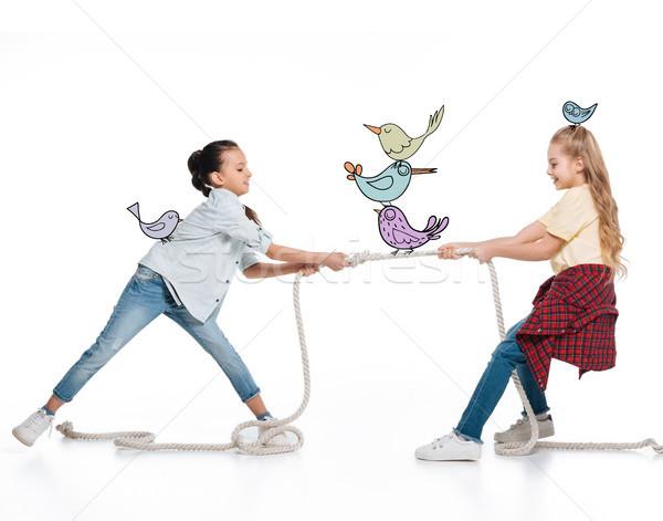 Lányok húz felfelé kötél vicces tündér Stock fotó © LightFieldStudios