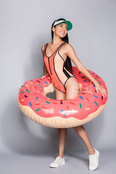 woman in swimsuit wearing pool float Stock photo © LightFieldStudios