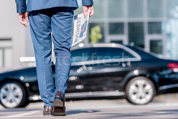 üzletember öltöny újság alacsony részleg elegáns Stock fotó © LightFieldStudios