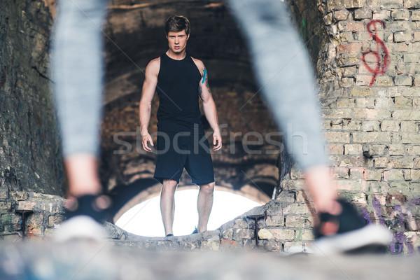 Fiatalember sportruha szelektív fókusz néz kamera áll Stock fotó © LightFieldStudios