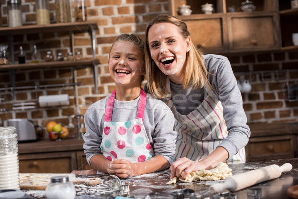 Stock photo: family having fun while cooking together