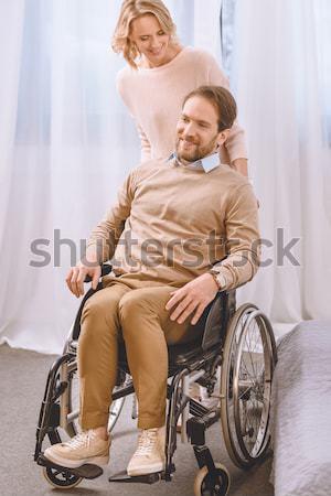 Joven silla de ruedas sonriendo sesión médico Foto stock © LightFieldStudios