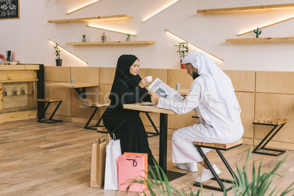 muslim couple spending time in cafe Stock photo © LightFieldStudios