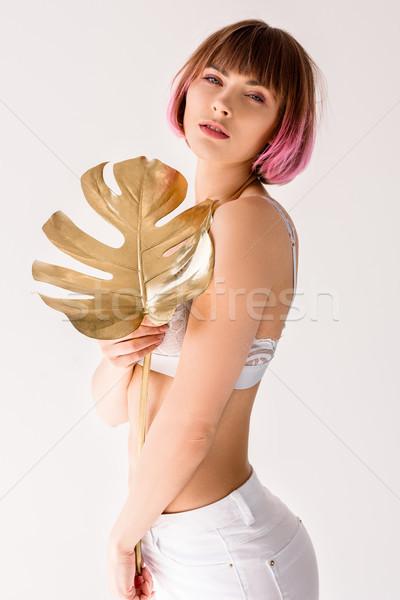 woman posing with golden leaf  Stock photo © LightFieldStudios