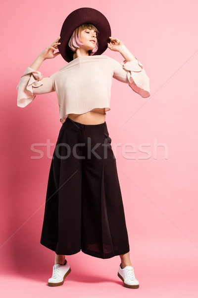 Trendy woman in wide-brimmed hat Stock photo © LightFieldStudios