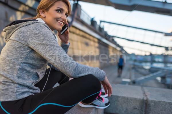 sportswoman talking on smartphone Stock photo © LightFieldStudios