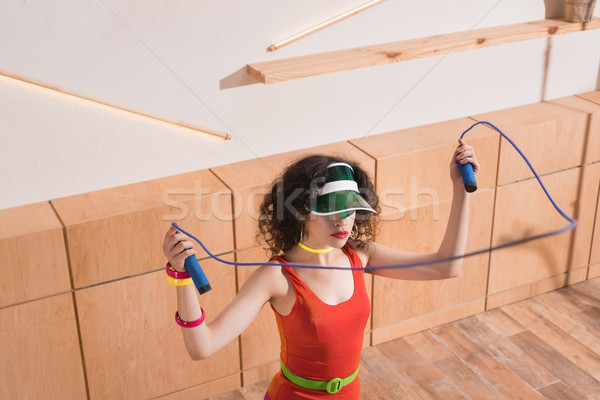woman exercising with skipping rope Stock photo © LightFieldStudios