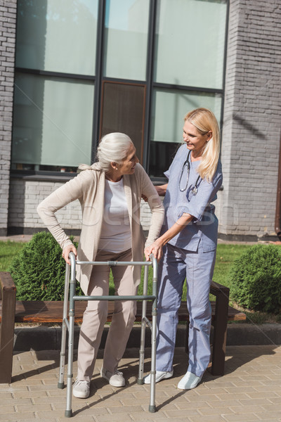 nurse and senior patient with walker Stock photo © LightFieldStudios
