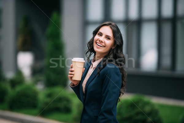 businesswoman with disposable cup of coffee Stock photo © LightFieldStudios