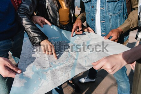 Multicultural amigos mirando cámara vista senalando Foto stock © LightFieldStudios