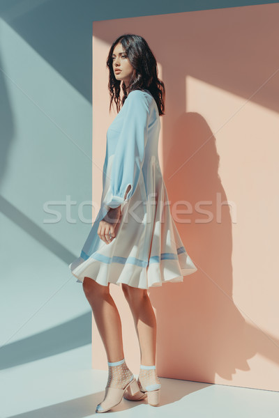 Femme mode turquoise robe élégant permanent Photo stock © LightFieldStudios