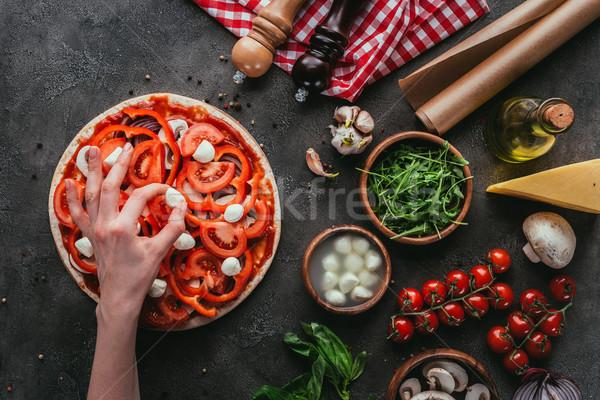 Lövés nő mozzarella darabok pizza beton Stock fotó © LightFieldStudios