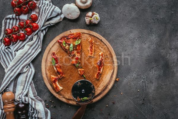top view of pieces of eaten pizza with cutter on concrete table Stock photo © LightFieldStudios