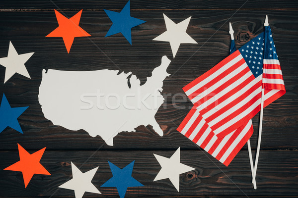 top view of arranged american flags, piece of map made of paper and stars on wooden surface, preside Stock photo © LightFieldStudios