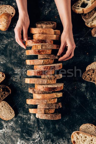 Lövés női kezek darabok kenyér sötét Stock fotó © LightFieldStudios