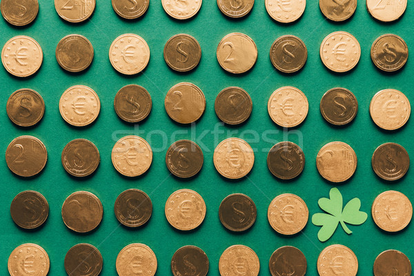 top view of pattern of golden coins and shamrock on green, st patricks day concept Stock photo © LightFieldStudios