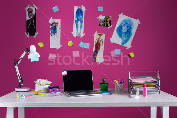 laptop with blank screen and office supplies at fashion designer workplace Stock photo © LightFieldStudios