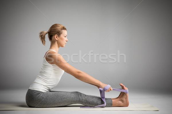 Athletic woman stretching  Stock photo © LightFieldStudios