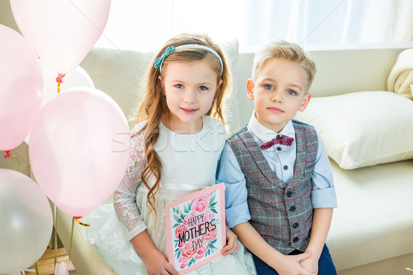 Siblings holding Mothers Day card Stock photo © LightFieldStudios