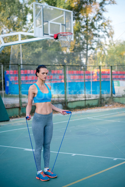 Woman working out with skipping rope Stock photo © LightFieldStudios