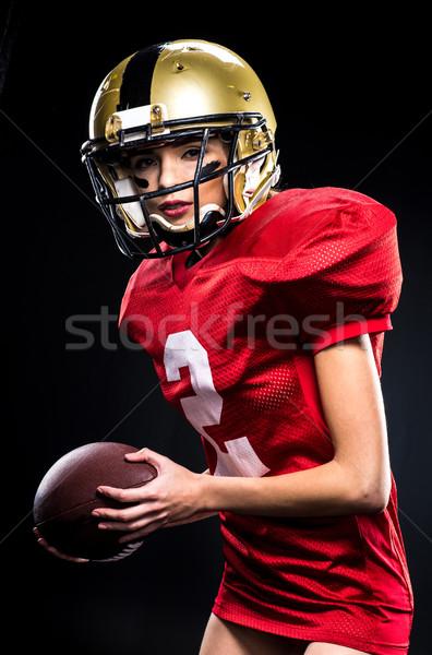 Kobiet odzież sportowa piękna amerykański kask Zdjęcia stock © LightFieldStudios