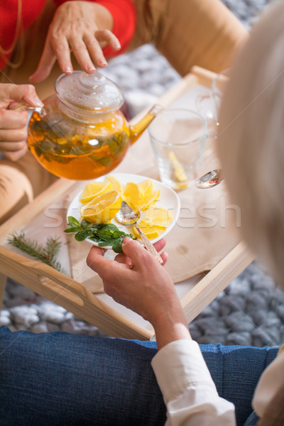Nő áramló tea ül padló citrom Stock fotó © LightFieldStudios