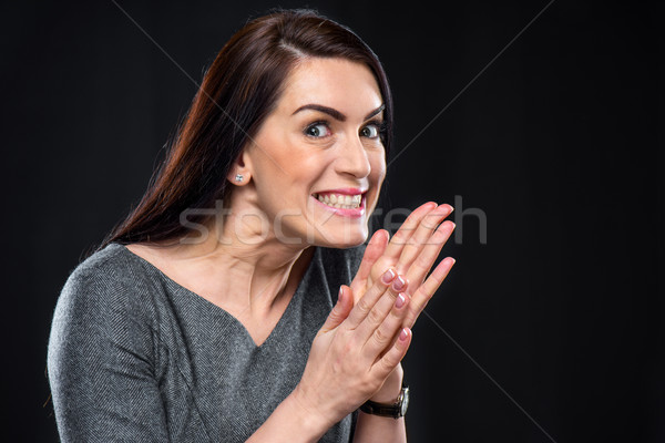 Scheming woman rubbing her hands  Stock photo © LightFieldStudios