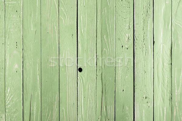 Világoszöld fából készült függőleges deszkák háttér tábla Stock fotó © LightFieldStudios