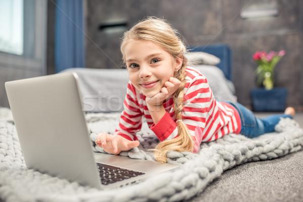 Girl using laptop Stock photo © LightFieldStudios