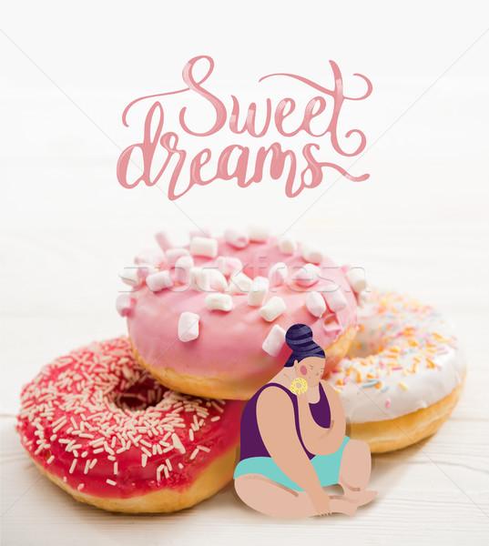 Fat woman sitting near pile of tasty donuts Stock photo © LightFieldStudios