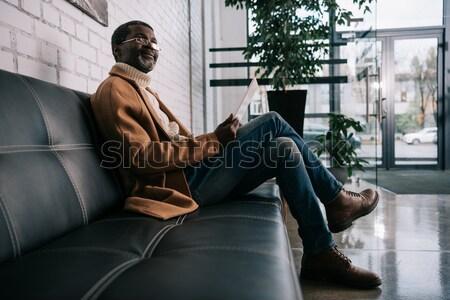 Seductive woman sitting on office desk Stock photo © LightFieldStudios