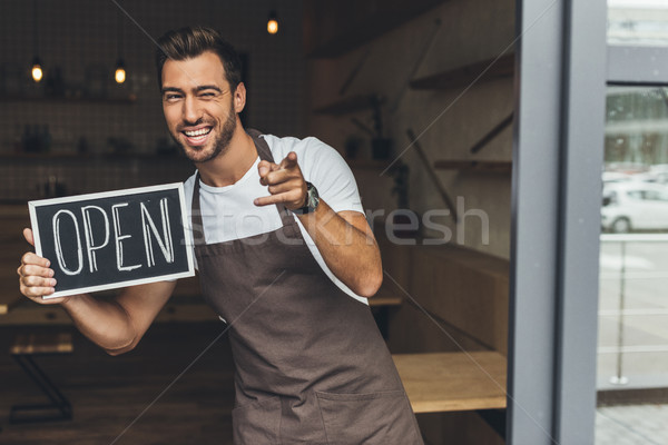 waiter holding chalkboard with open word Stock photo © LightFieldStudios