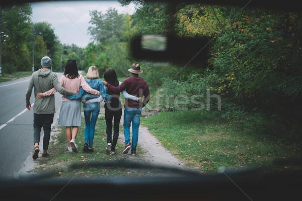 friends walking together Stock photo © LightFieldStudios